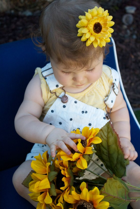 Joy-playing-with-flowers